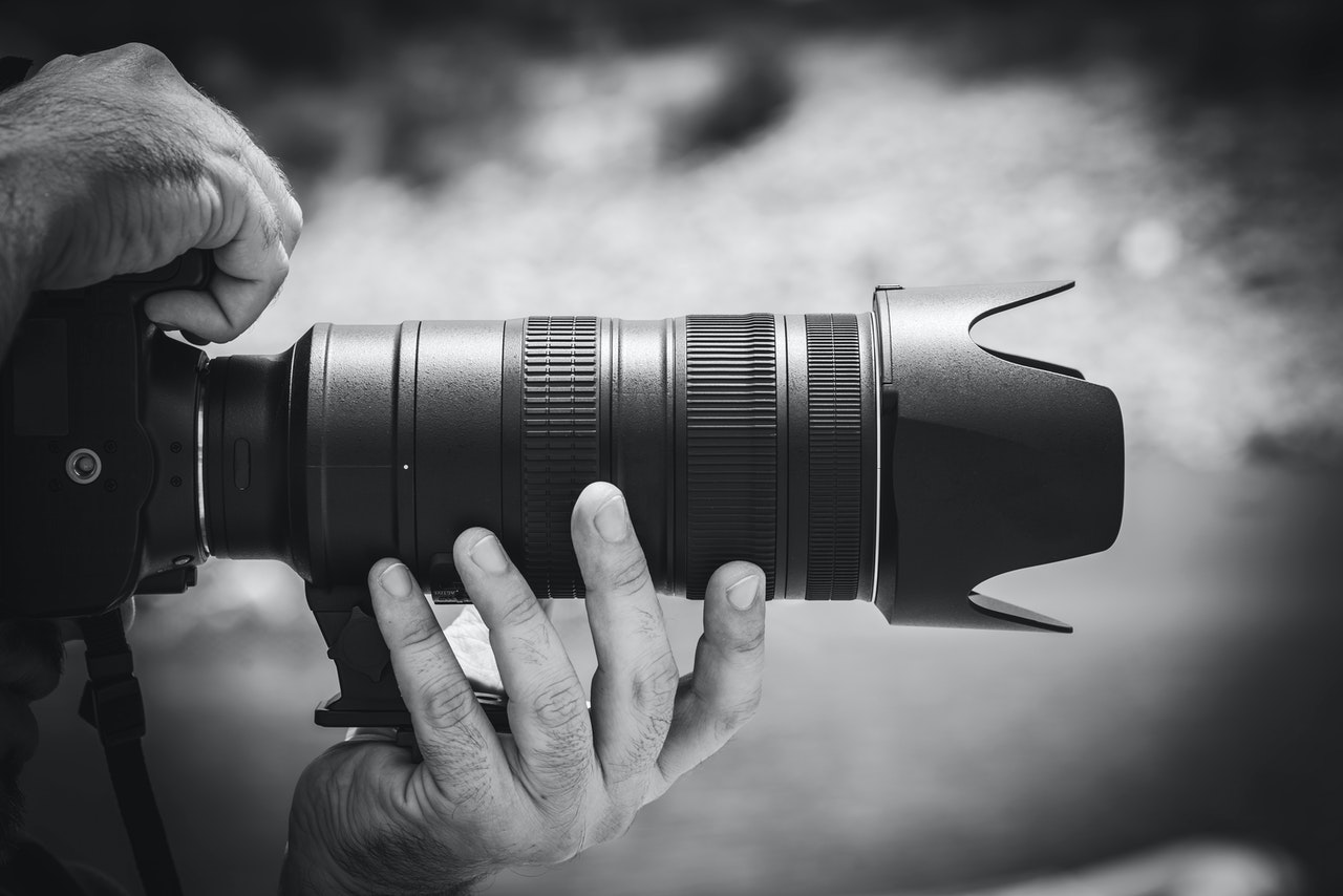person-holding-camera